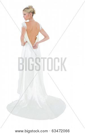 Rear view of woman wearing luxurious wedding dress over white background