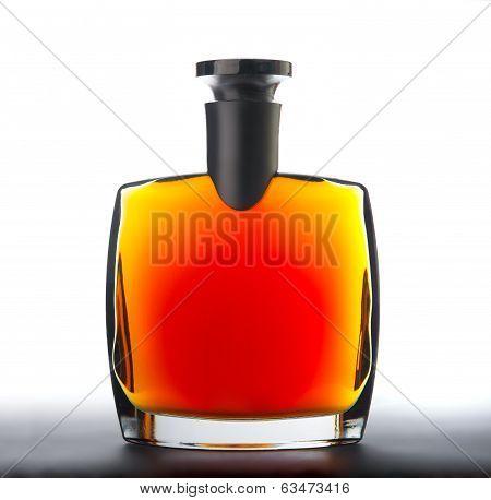 The bottle of brandy (cognac)