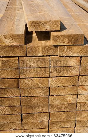 Stacks of wood planks in lumber yard