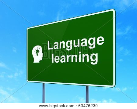 Education concept: Language Learning and Head With Light Bulb on road sign background