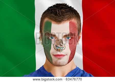 Composite image of serious young mexico fan with facepaint against digitally generated mexican national flag