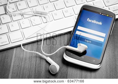 Facebook Application On Smart Phone Screen.