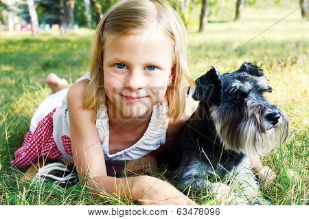 Smiling Little Girl Hugging Her Dog