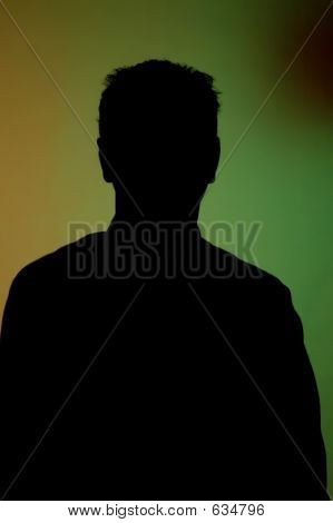 Silhouette Of A Man Against Colourful Backdrop