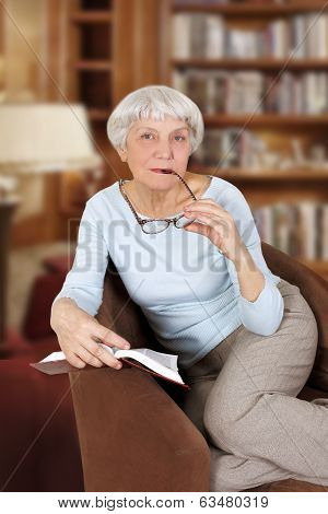 Elderly Woman With Book And Glasses