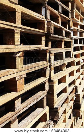 Wooden transport pallets in stacks