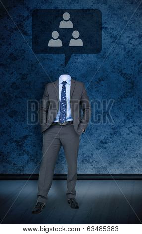Composite image of headless businessman with speech bubble against dark grimy room