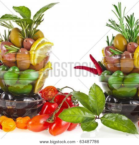 Border frame of olives dish with vegetables, herbs, spices isolated on a white background