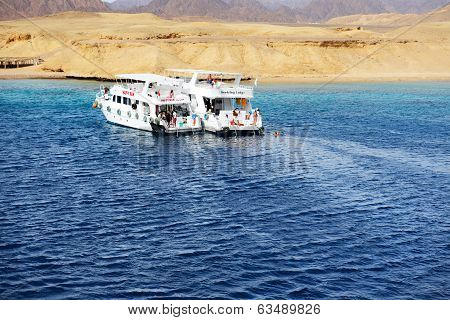 Sharm El Sheikh, Egypt -  December 4: Snorkeling Tourists And Motor Yachts On Red Sea In Ras Muhamma