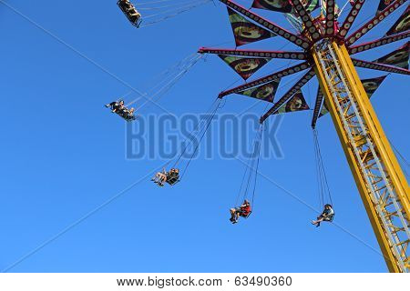 Coquitlam BC Canada - April 13 2014 : Flying swing carousel against blue sky in Coquitlam BC Canada.