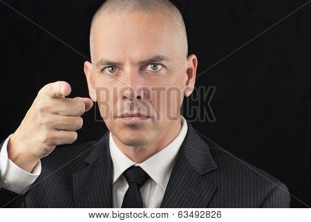 Intense Bald Man Points To Camera