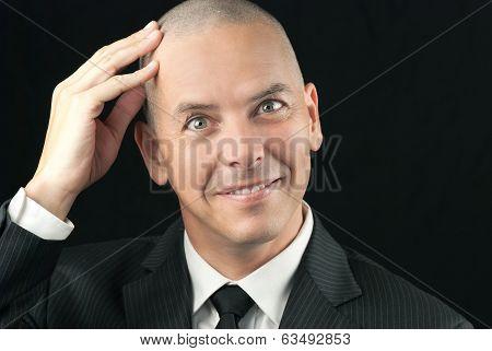 Happy Bald Man Feels Head