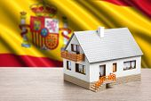 classic house against Spanish flag background