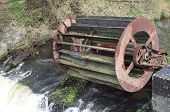 foto of water-mill  - old inoperative water mill on river background - JPG