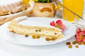 foto of curd  - Curd cottage cheese pie slice with raisins on plate