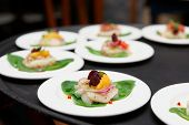 Sea scallop carpaccio dishes ready for serving