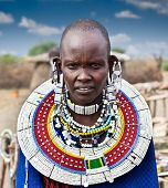 TANZANIA, AFRICA-FEBRUARY 9, 2014: Masai woman with traditional  ornaments, review of daily life of
