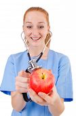 Pretty doctor  in blue uniform  with stetothcope and apple isolated on white