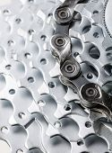 stock photo of mountain chain  - Rear mountain bike cassette with chain close - JPG
