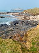 pic of st ives  - Godrevy lighthouse and island St Ives Bay Cornwall coast England UK facing the Atlantic Ocean and popular with surfers - JPG