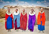 TANZANIA, AFRICA-FEBRUARY 9, 2014: Masai women with traditional  ornaments, review of daily life of