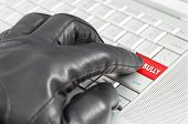 stock photo of unsafe  - Online bully concept with hand wearing black glove - JPG