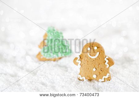 Gingerbread man and christmas tree  on a festive Christmas snow background, nice postcard