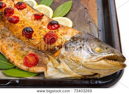 Entire Salmon Cooked With Tomatoes ,lemon And Laurel