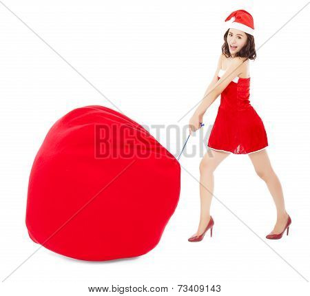 Young Female Pull A Heavy Gift Bag With Christmas Suit
