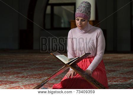 Muslim Woman Reading The Koran