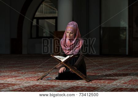 Muslim Woman Reading The Koran
