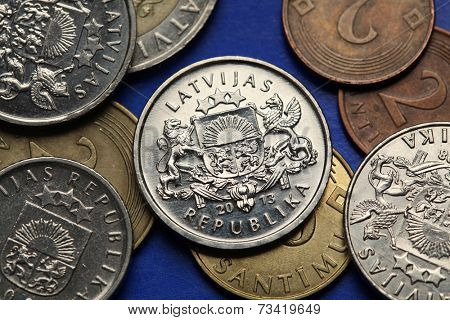 Coins of Latvia. Latvian national large coats of arms depicted in old Latvian lats coins.