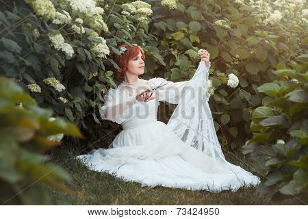 Girl With Scissors Makes The Wedding Dress.