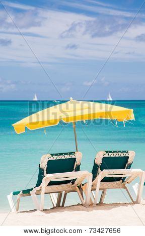 Green Chairs Under Yellow Umbrella In Paradise