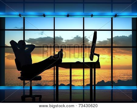 Silhouette of a man in a chair in office.