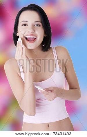 Closeup portrait picture of beautiful woman with cotton pad
