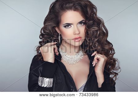 Attractive Brunette Girl Model With Long Wavy Hair Styling, Makeup And Fashion Jewelry Isolated On G