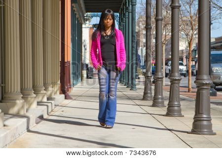 Woman Walking On Sidewalk