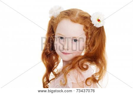 Little red haired girl with a bows. Girl is six years old.