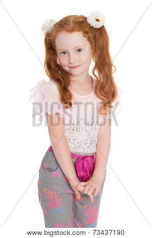 Little redhead fashionista in a  jeans. Girl is six years.