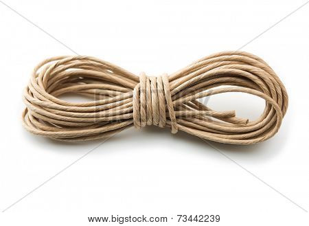 Batch or roll of brown packaging cord or twine, isolated on white.
