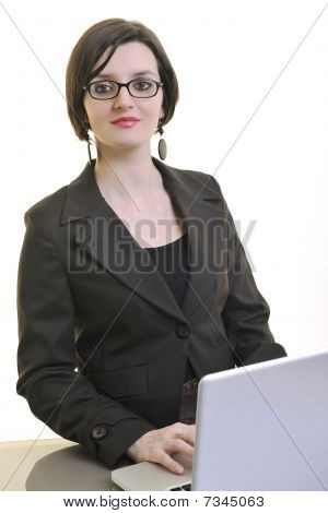 Business Woman Working On Laptop Isolated On White