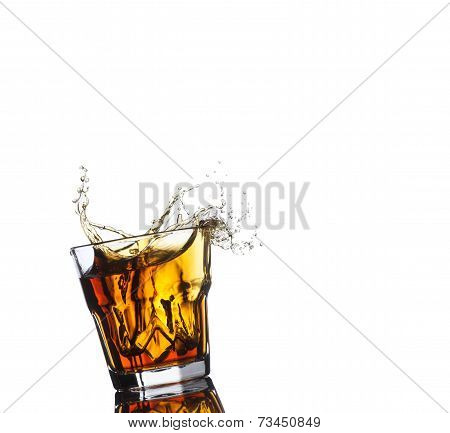Isolated shots of whiskey with splash on white