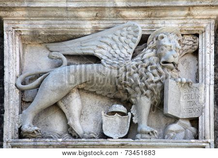 KOTOR, MONTENEGRO - JUNE, 10: Relief sculpture of venetian winged lion, made from marble, placed on defending wall of town of Kotor, Montenegro on June 10, 2012