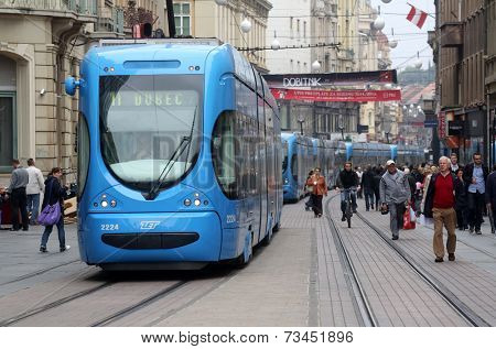 ZAGREB, CROATIA - OCTOBER 04: Blue city trams stay in a traffic jam in the city center in Zagreb, on October 04, 2014