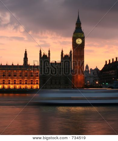 Big Ben just after sunset with speeding boat