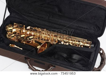 Saxophone In Open Case On White Background