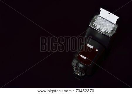 Camera flash, focus on reflector