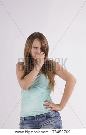 Young Woman Covers Her Nose
