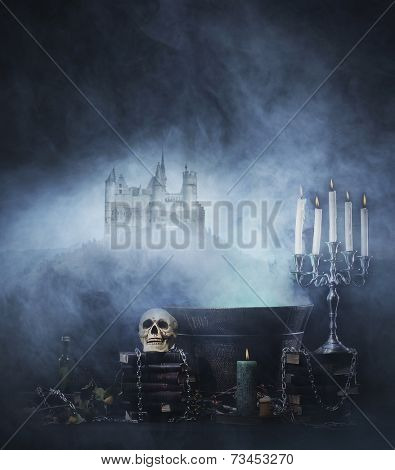 Halloween background with a spooky witchcraft tools over an ancient castle background